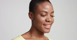 closeup Portrait of a smiling happy attractive young black model with beautiful skin isolated on white