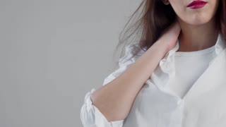 closeup portrait of youn woman model in studio with blowing hair and bright pink lips. Slowmotion blowing hair, ideal skin