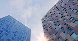 corporate buildings. Reflection of sky in sky-scraper