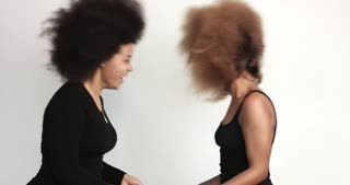 couple of black womans with huge afro hair dancing and shaking heads
