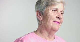 eldery woman portrait looks at camera