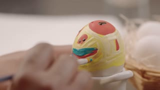 funny colored face painted on easter egg