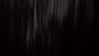 Hair texture background, no person. Black shiny hair comb texturte