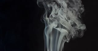 High contrast video of white smoke moving upwards isolated on black