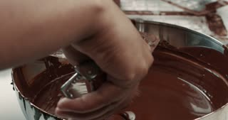 liquid chocolate texture. Process of making a chocolate bars
