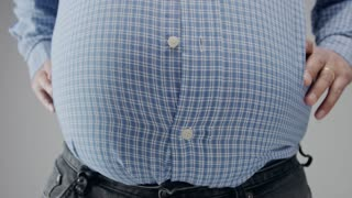 loose weight concept. Overweight man loosing weight. Belly disapearing and man closed the buttons of shirt