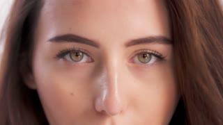 macro closeup face Closeup woman's eyes green-brown eyes looking at camera and aside