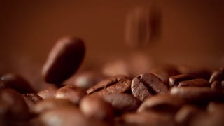 macro of coffee beans slowmotion falling in studio