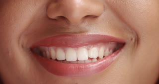 mixed race black woan's mouth closeup smiling front view