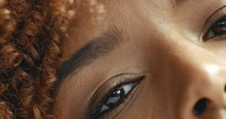 mixed race black woman's eyes closeup. brown eyes closeup