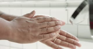 mixed race man's hand with a lotion after shave