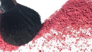 pink makeup powder texture moving on white