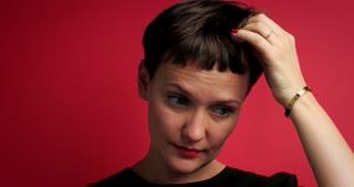 pretty woman in red background studio portrait