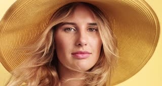 Smiling blonde woman wearing hat video