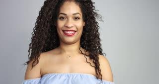 smiling mixed race woman watching at camera.