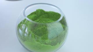 transparent bowl with matcha powder