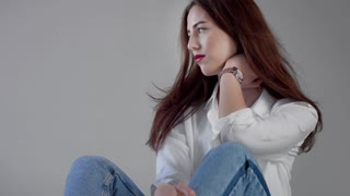 woman in industrial studio wears jeans and white shirt blowing long hair rose bright lips. Classick jeans outfit Closeup portrait