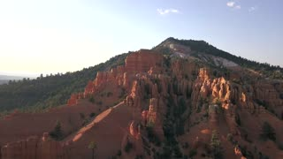 Aerial Bryce Canyon Red Canyon landscape climb forward fast. Red Canyon near Park within Dixie National Forest in southwest Utah. Geological structures called hoodoos formation weather water erosion.