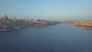 Aerial panorama view of ancient capital city of Valletta Malta with port, cathedral and old town during sunset. Island Country of Europe in the Mediterranean Sea