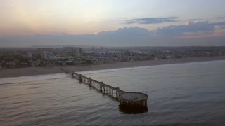 Aerial view of the pier near Venice beach in Los Angeles during sunrise.