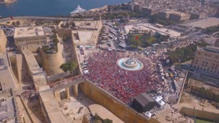 Aerial view of the Valletta city celebrating Labour party. Thousands of people walking down the streets of the old town in Valetta, Malta
