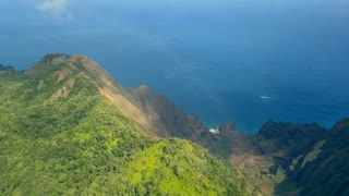 Amazing aerial view of the exotic paradise island and Napali coast at Kauai island Hawaii Cliffs with a rainbow by the Pacific ocean