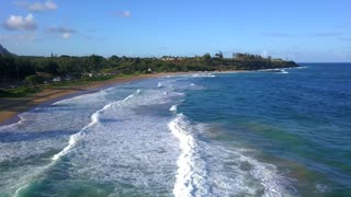 Amazing aerial view of the Hawaii nature, beac, Pacific ocean waves during sunset time. View on the beach at the Kauai island