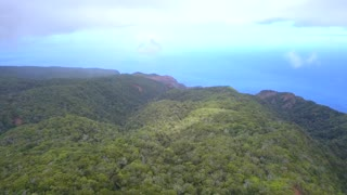Astonishing aerial views of the Kauai island from above with forests jungles, Pacific ocean and Na Pali cliffs
