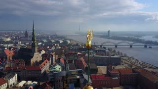 Beautiful view of the Riga old town with St. Peters cathedral and a golden cock on the top of the Domes cathedral. Can see TV tower as well.