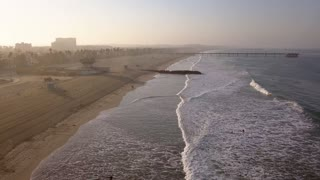 Los Angeles city coastline aerial view from above during sunrise.