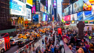 May 10, 2019. New York, USA. Time Square time lapse view. People walking down the Time square in New York. The flow of time.