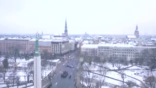 RIGA - 20 January, 2018: Amazing Aerial View of the Statue of Liberty Milda in Riga, Latvia during winter day when it is snowing, Statue of Liberty holding Three Golden Stars.