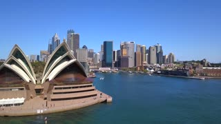 Sydney opera house aerial shot over the bay with the Sydney skyline behind it. April 10, 2017. Sydney, Australia.