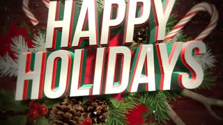 Animated close up Happy Holidays text and green Christmas branches