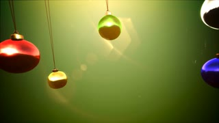 Animated close up Happy Holidays text, colorful balls on green background