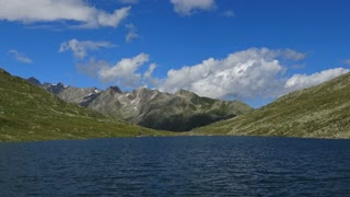 Time lapse view on peak of mountains and lake in Swiss Alps
