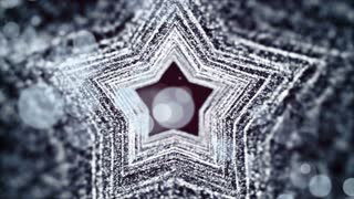 Silver particles in motion, in the form of star.