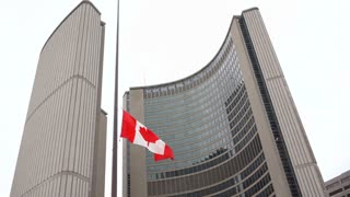 Canadian flag flying at half-mast at Toronto city hall.