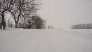 Driving on a snow covered lonely rural road.
