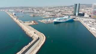 Cruise Ship terminal and port in Marseilles. Breakwater sea wall protecting huge docks in France for major tourist cruise line boarding area.