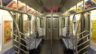 Empty subway in NYC travels in Manhattan. No people on New York metro during daytime on 7 train downtown.