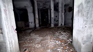 POV shot walking through scary abandoned factory at night 2of2.Pitch black wandering around horror scene with debris and graffiti. Lost in dangerous warehouse in the dark with no way out, no escape.