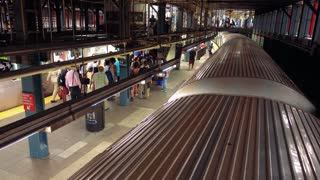 Subway train and platform from above.