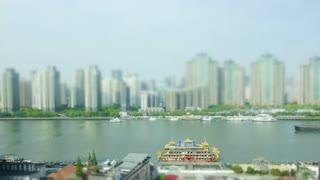 Tilt shift timelapse of Shanghai Huangpu river ships moving past.