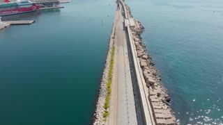 Very long breakwater for docks at Marseilles for cruise boats. Marseille cruise ship port in France with large wall to protect from sea currents. Protected marina in Mediterranean sea.