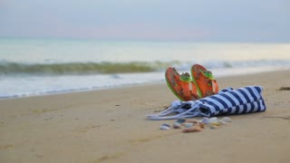 Beach accessories, on sandy beach, sea and blue sky background for summer holiday and vacation concept