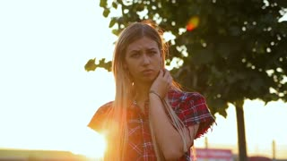 beautiful girl is nervous and smokes at sunset