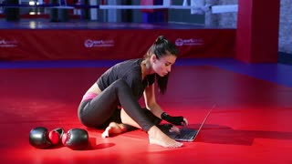 business woman works on the computer in the gym