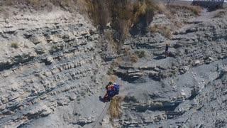 Gelendzhik, Krasnodar/Russia - August 18 2018: rescue of a man fallen from a cliff. Rest on the sea is not safe