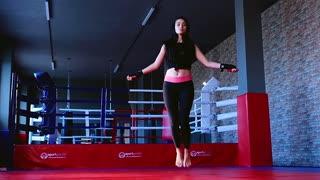 girl kickboxer jumping rope
